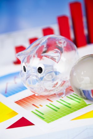 Finance concept with globe sphere and piggybank