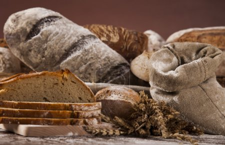 Photo for Freshly baked bread on the wooden table - Royalty Free Image