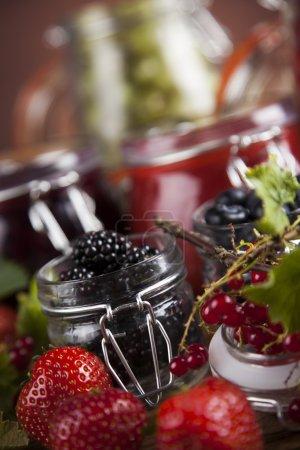Homemade fruit jam in the glass jars