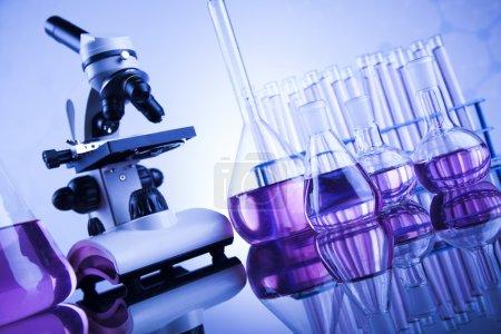 microscope and glassware in laboratory