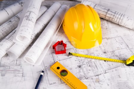 Yellow helmet, project drawings and house model