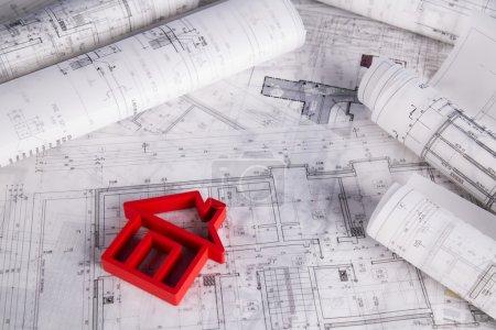 House under construction, blueprints concept