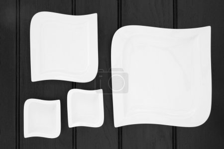 Square shaped modern plates of varying sizes over ...