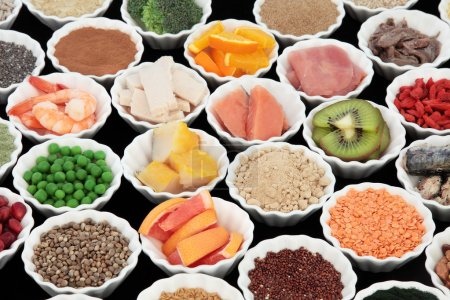 Photo for Body building high protein health food of meat and fish with supplement powders, grains, seeds, pulses, fruit and vegetables. Selective focus. - Royalty Free Image