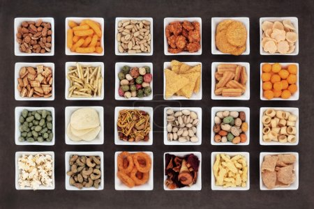Photo for Large savoury snack food selection in square porcelain bowls. - Royalty Free Image