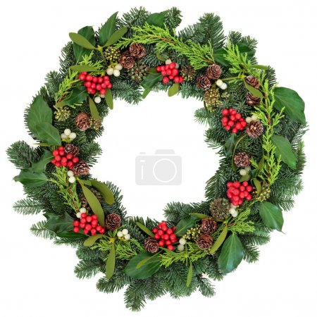 Photo for Christmas wreath with holly, ivy, mistletoe and winter greenery over white background. - Royalty Free Image