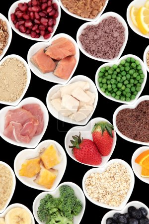 Photo for Body building high protein health food of meat and fish with supplement powders, seeds, fruit and vegetables. - Royalty Free Image