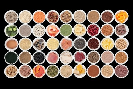 Photo for Large health and body building high protein super food with high nutritional values including meat, fish, dairy, pulses, cereals, grains, seeds, supplement powders, fruit and vegetables. - Royalty Free Image