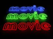 Movie Neon Sign on Street with glowing