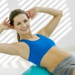 Photo of attractive smiling woman doing workout wi...