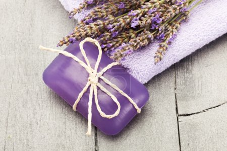 Lavender soap over wooden table