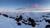 Beautiful spring sunset landscape in the snow capped mountains