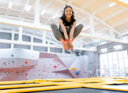 Photo for Happy brunette jumping on trampoline - Royalty Free Image