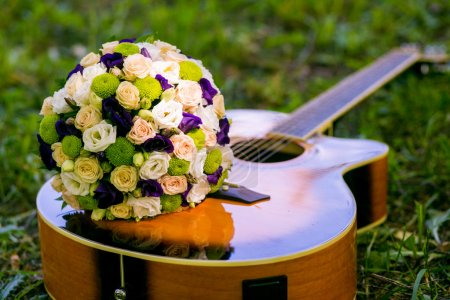 Wedding bouquet of colorful flowers lying on the g...