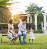 Asian family playing and enjoying