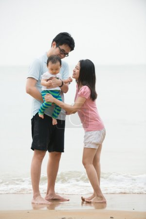 Asian family on beach