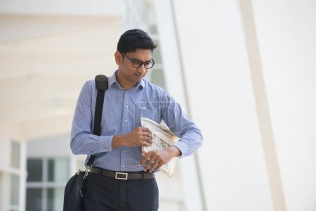Indian man checking on new office