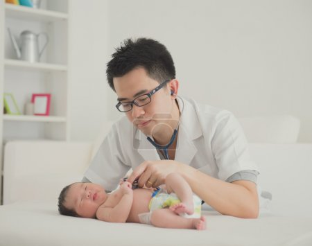 Asian newborn  with doctor