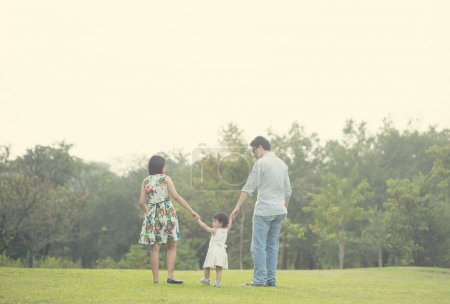 Photo for Asian family playing and enjoying quality time outdoor , vintage tone - Royalty Free Image