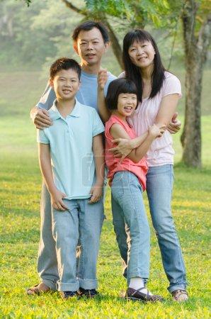 Asian Family Enjoying Walk