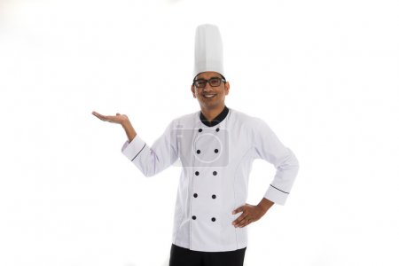 indian male chef introducing something