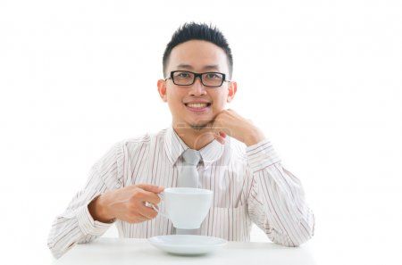 Asian business man drinking coffee