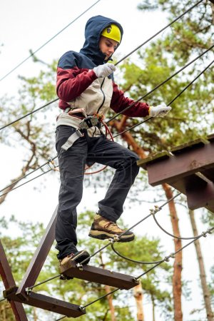 Teenage boy in an adventure park