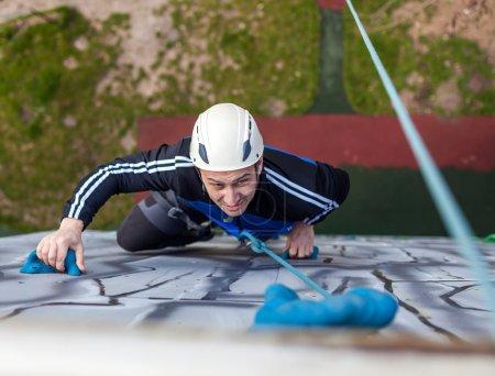 Man climbing a wall