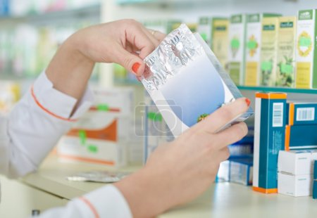 pharmacist woman picking a medicine