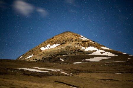 mountain peak and stars at midnight