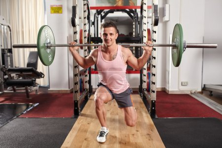 Man doing barbell lunges