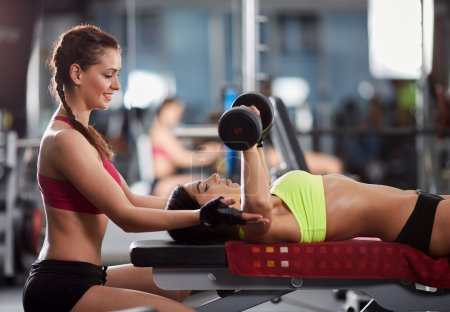 woman personal trainer helping