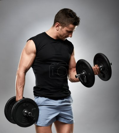 Athlete doing biceps curl
