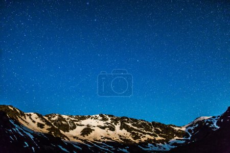 Mountain peaks with stars