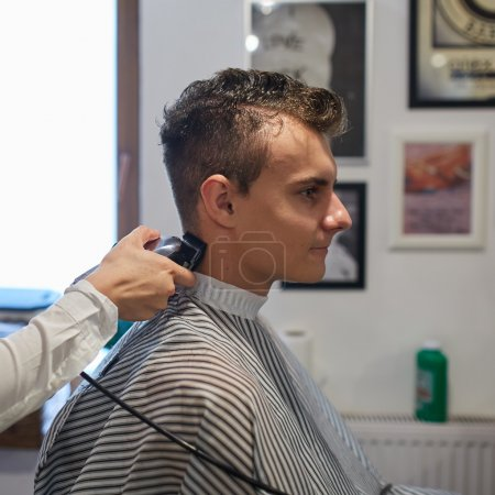 Teenager getting a haircut