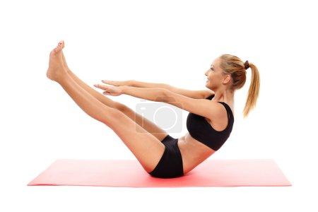 Fitness girl doing abs