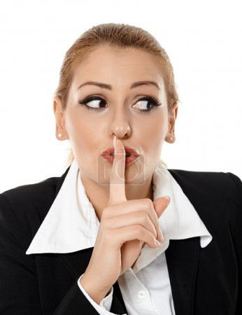 Businesswoman making silence sign