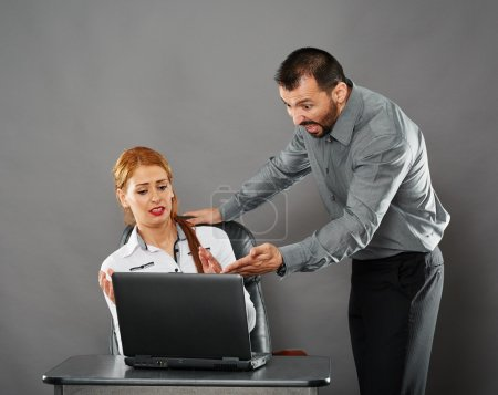 Angry boss shouting at employee