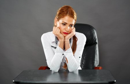 businesswoman sitting at her desk