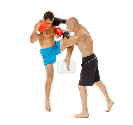 Two kickbox fighters sparring