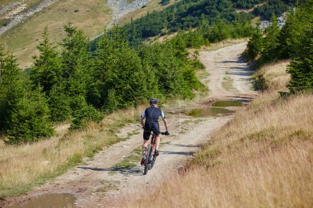 cyclist  riding on rugged trails