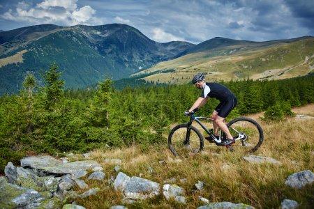 cyclist  riding on rugged trails