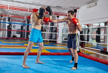 Photo for Two muay thai fighters in a sparring match in the ring - Royalty Free Image