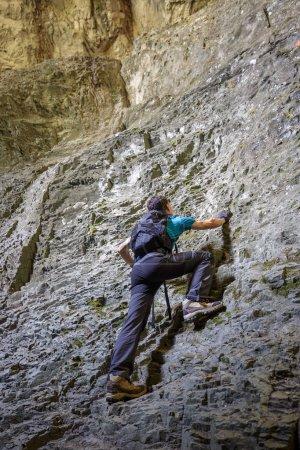 Teenage boy doing free climbing