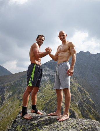 Kickbox partners shaking hands