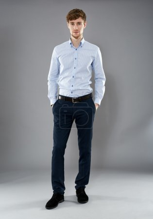 Photo for Full length portrait of a young handsome businessman with hands on pockets - Royalty Free Image