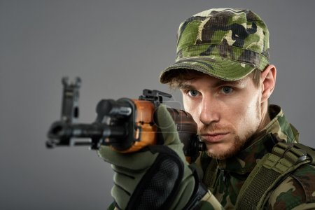 Soldier with machine gun aiming