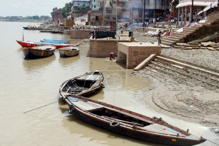 Boats at river coast in Indian city