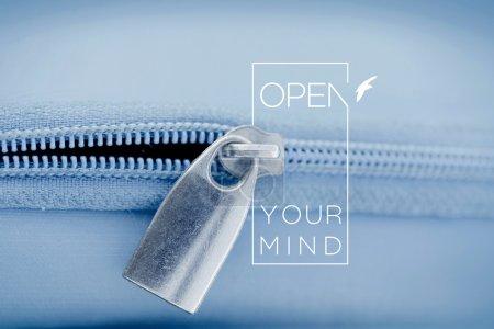 Open mind quote concept macro zipper background