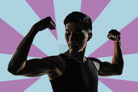 Photo for Silhouette of young man show his biceps brachii, closeup portrait. - Royalty Free Image